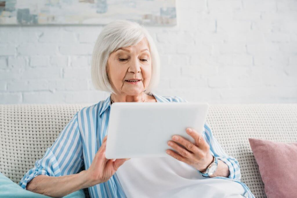 Person on Couch with Tablet