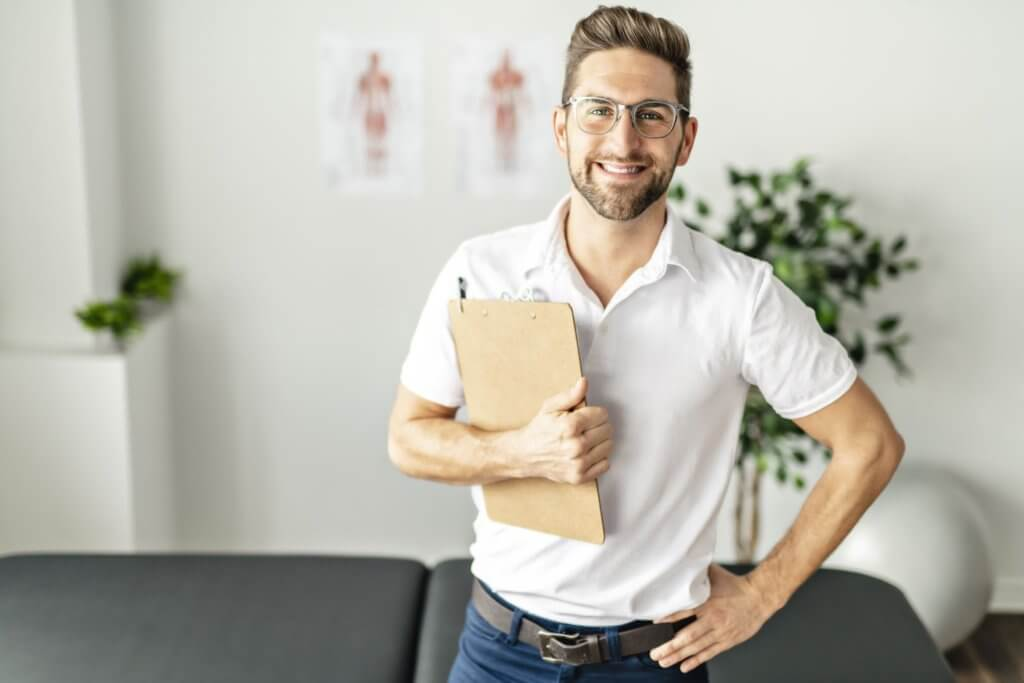 Chiropractor holding a patient chart