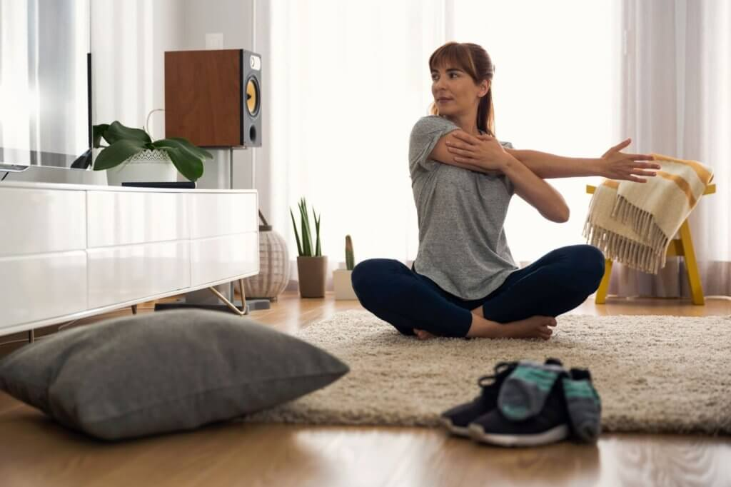 Woman sitting on the floor stretching