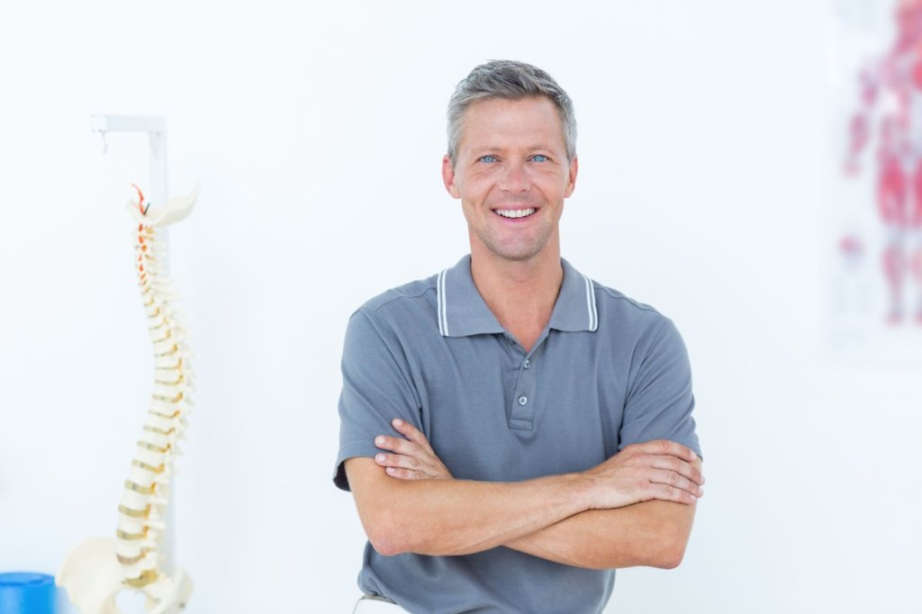 Smiling Chiro with Spine Model