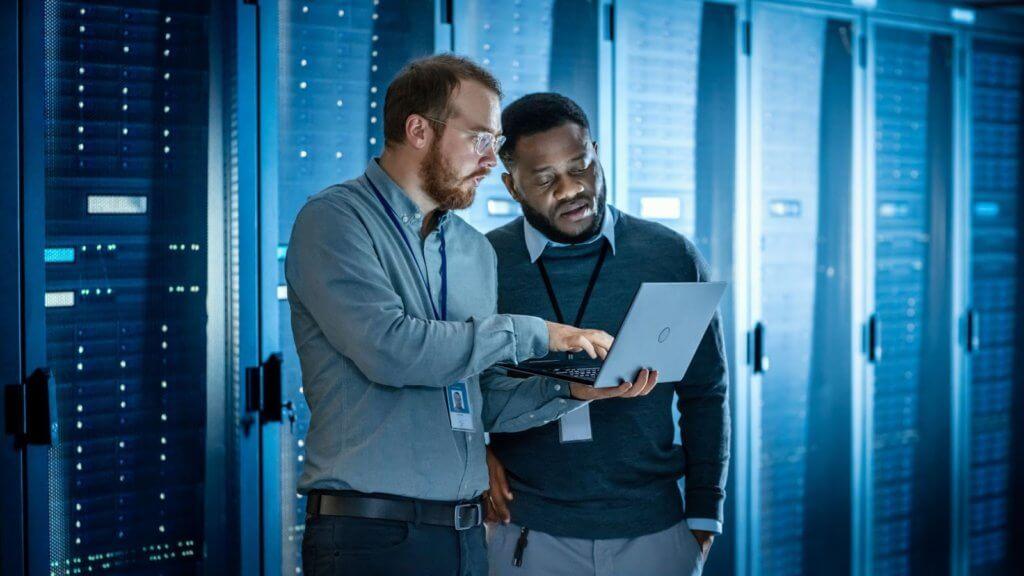 Two men near cloud servers