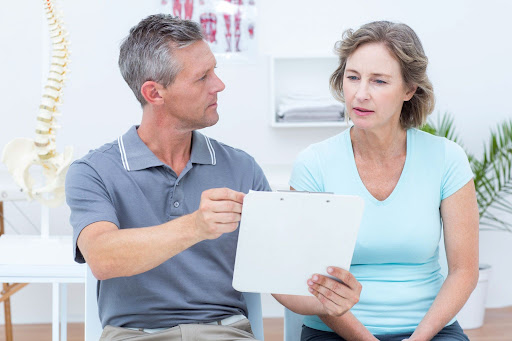 Chiropractor having a discussion with a patient